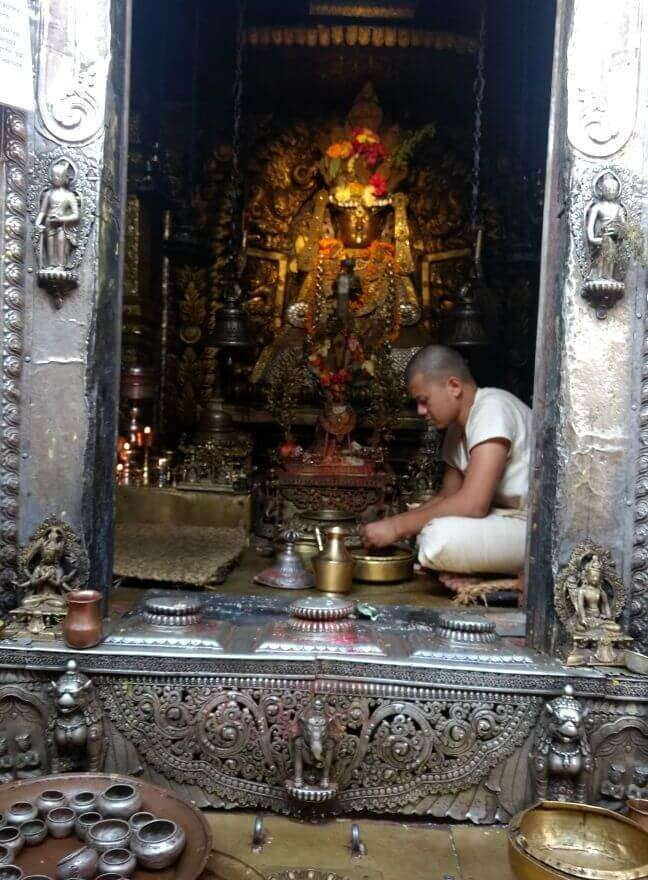 narayan and his wife seeking blessings at hindu temple in nepal