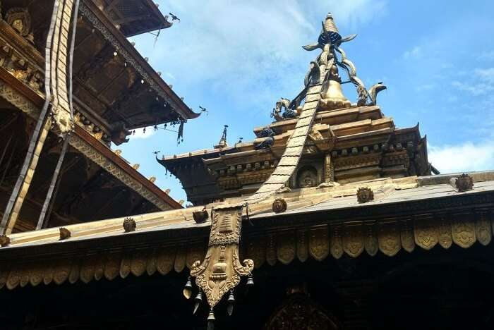 narayan checking out religious site in nepal with gorgeous architecture