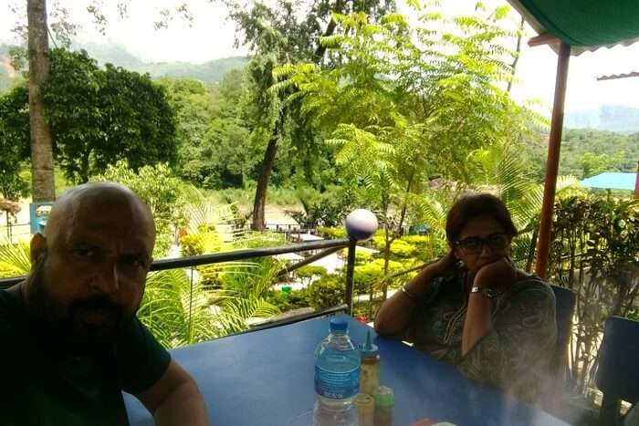 narayan and his wife having lunch at riverside restaurant on their nepal holiday