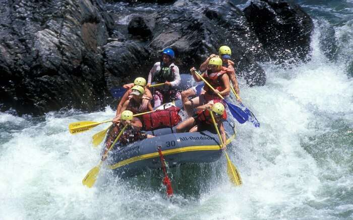 Rafters trying to maintain balance while rafting in Nepal
