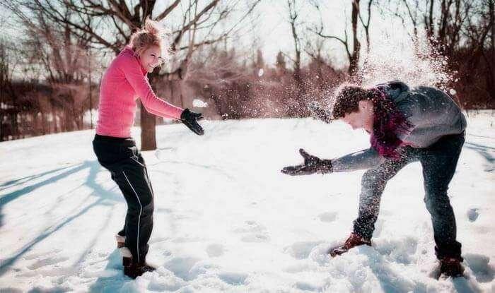 Couple enjoying snow