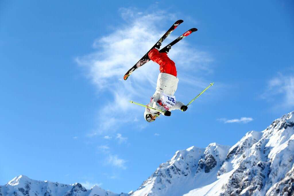 a guy flipping in the air while skiing
