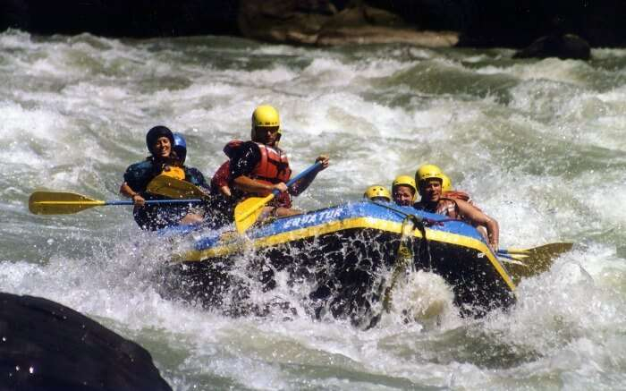 Thrilled adventurers on a boat in Sun Koshi River in Nepal