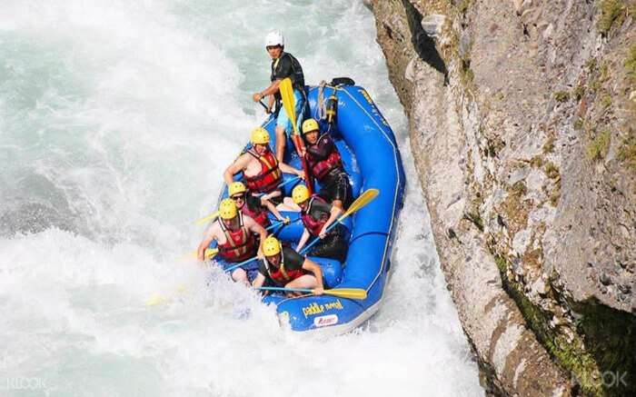 Top view of a boat with rafters in Upper Seti River in Nepal