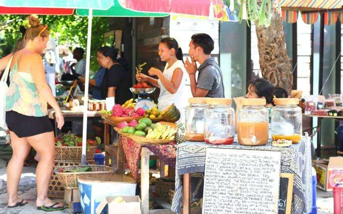 Tourists at local Sunday market in Canggu in Bali