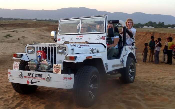Tourists enjoying jeep safari
