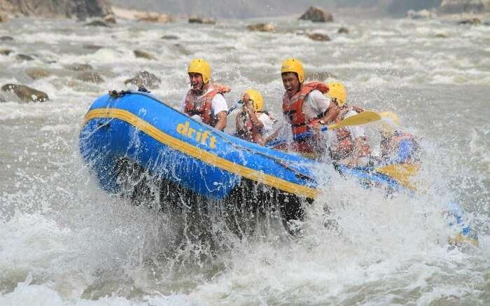 Youngsters enjoying rafting in Trishuli river in Nepal