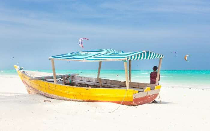 a traditional colorful boat at sea shore in Kenya