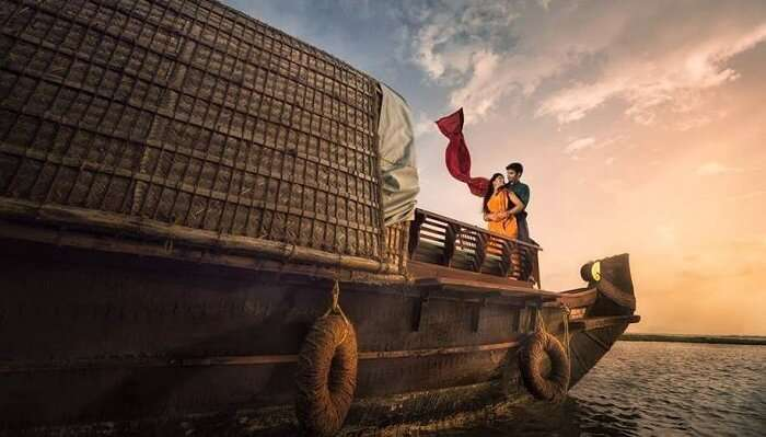 couple spending romantic moments on houseboat in alleppey