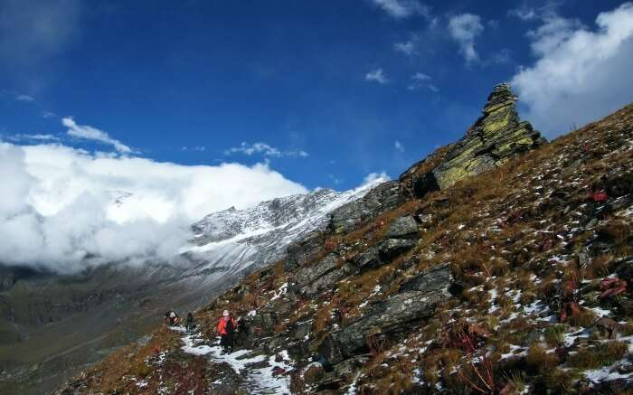 people trekking Nanda Devi Peak