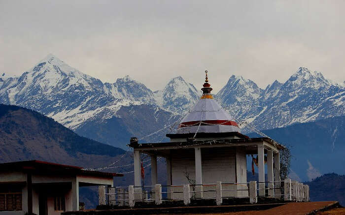temple with snow covered mountain background