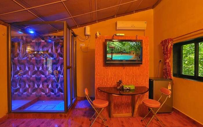 A beautiful resort with a large tv and wooden decor