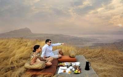 A couple sitting in a resort near Mumbai