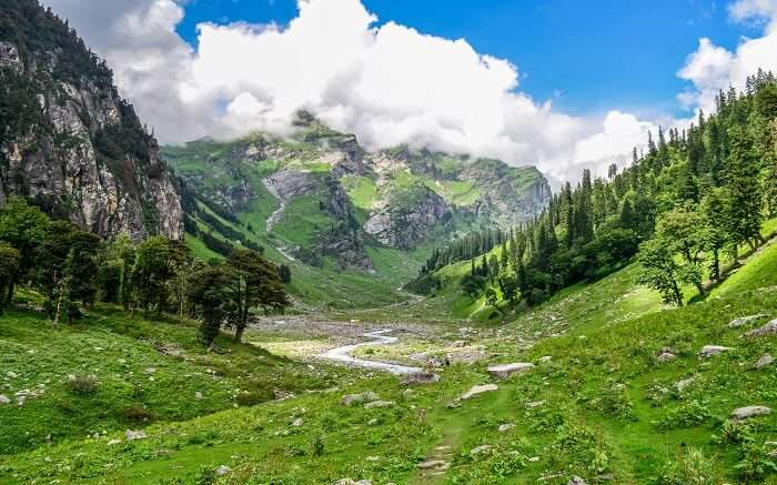 A lush green mountain pass enroute Hampta Pass Trek in Himachal