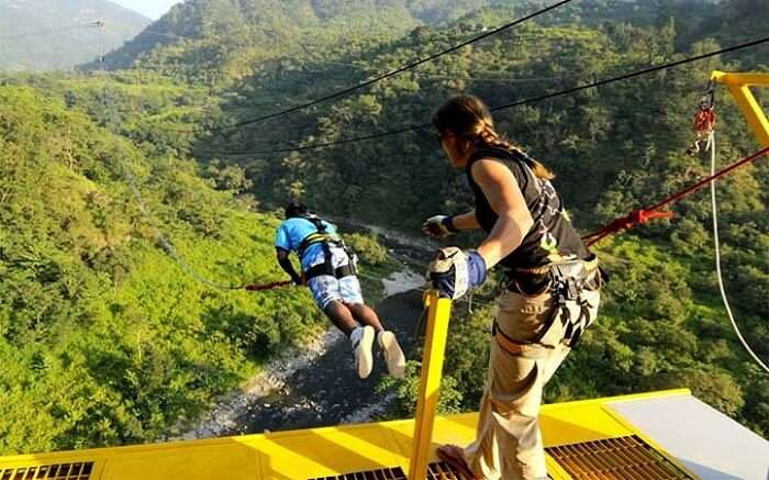 A person in blue t-shirt trying bungee jumping in Rishikesh