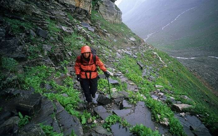 A traveller walking the rocky path during the Hampta Pass trek near Manali
