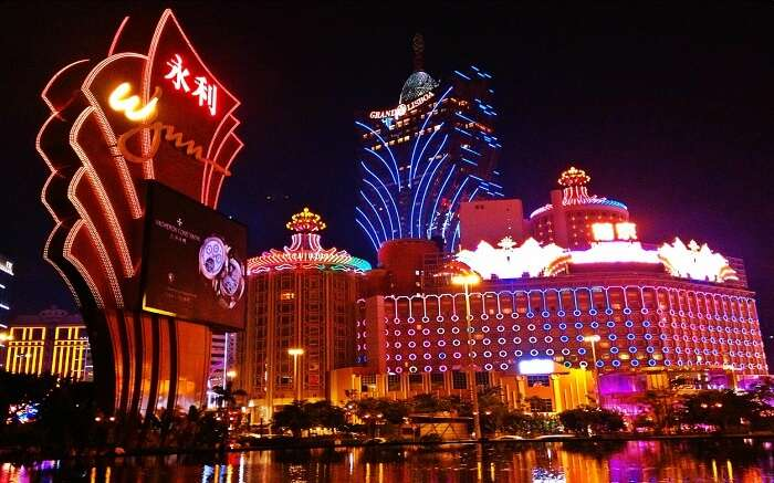 A well lit casino and other buildings