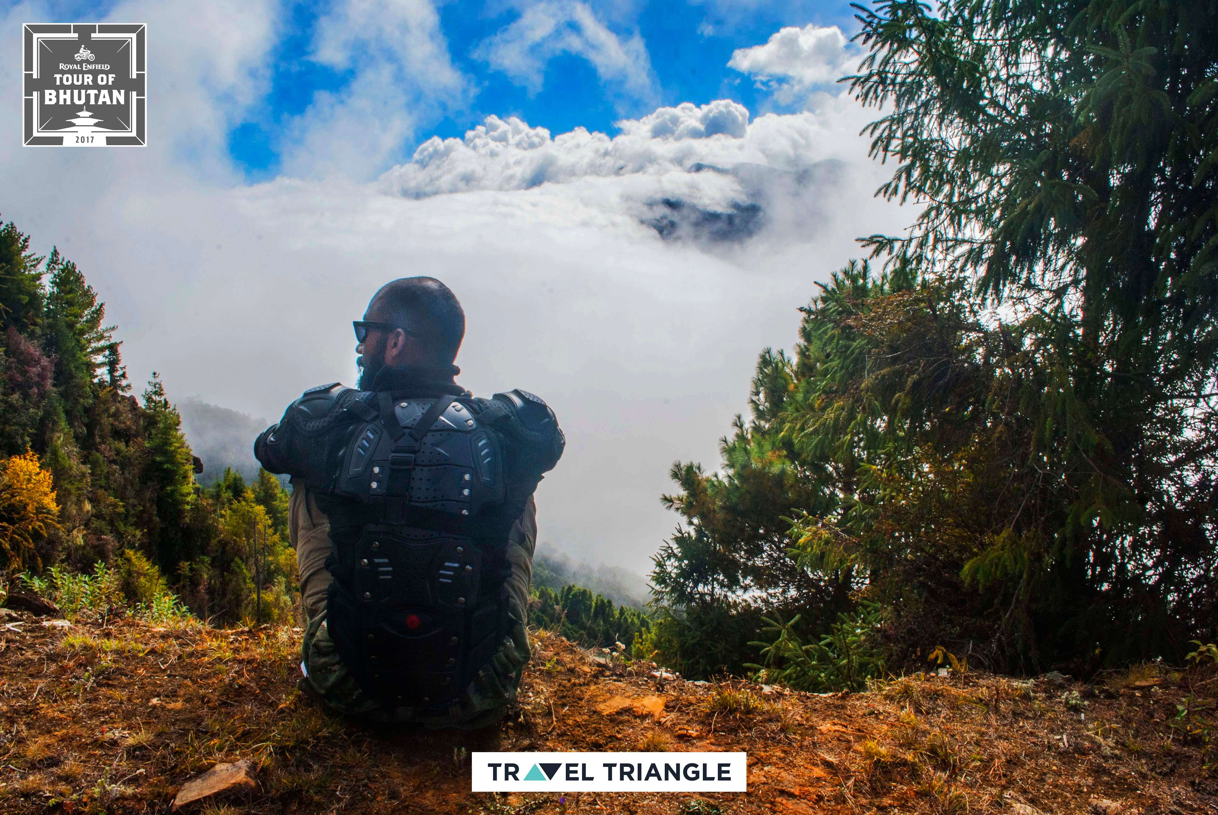 Bumthang to Mongar: siddharth sitting on the edge of a hill
