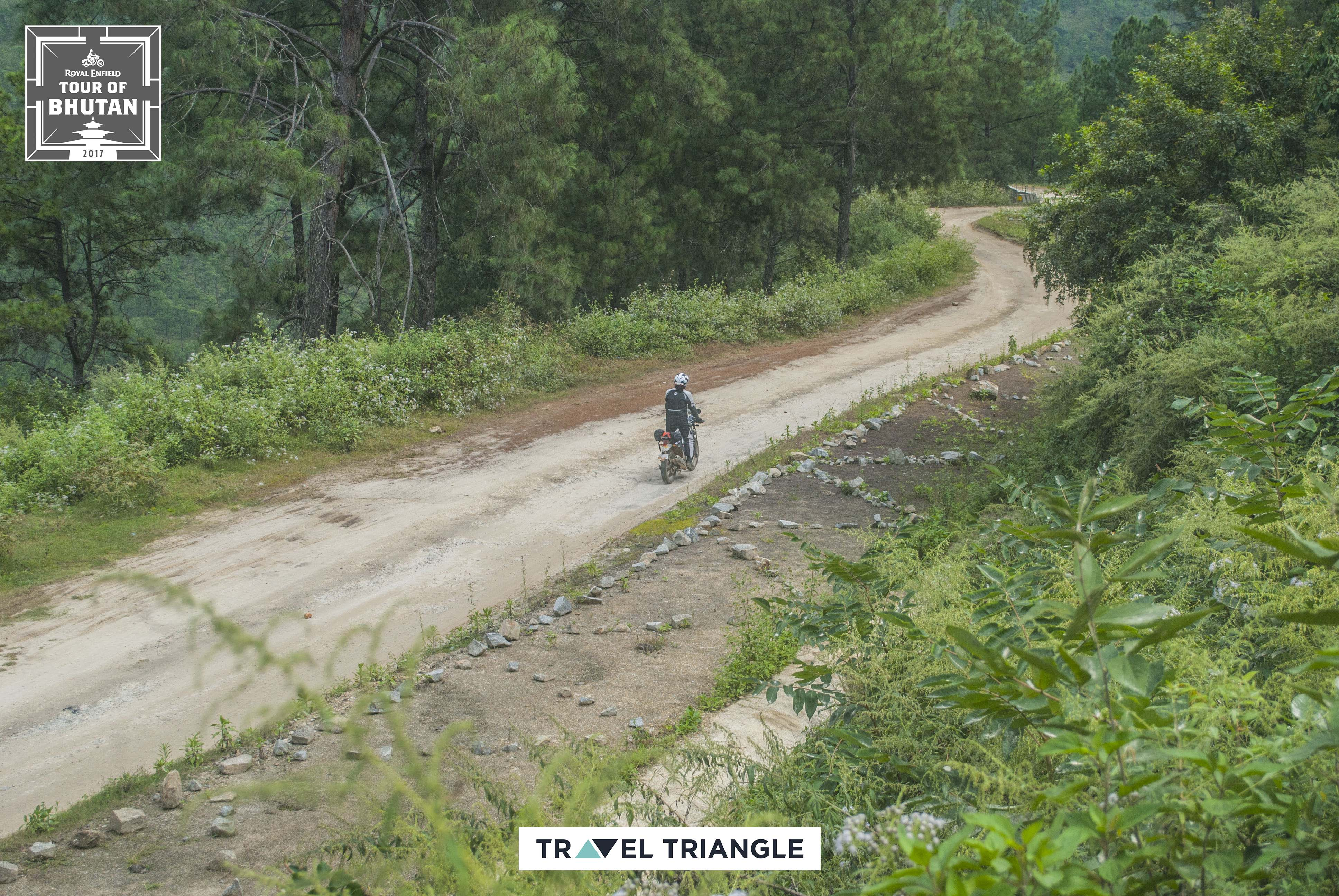 Mongar to Trashigang: top view of a rider riding off