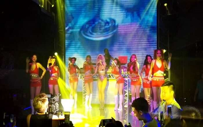 Girls performing in a bar at night