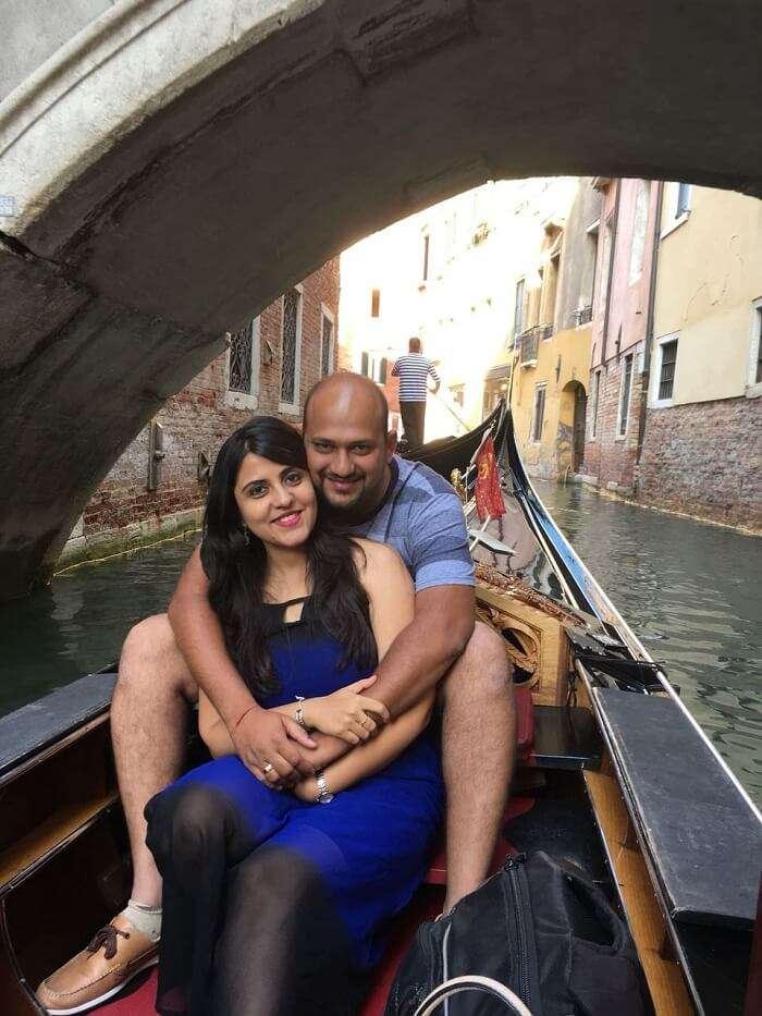 couple taking a gondola ride in venice