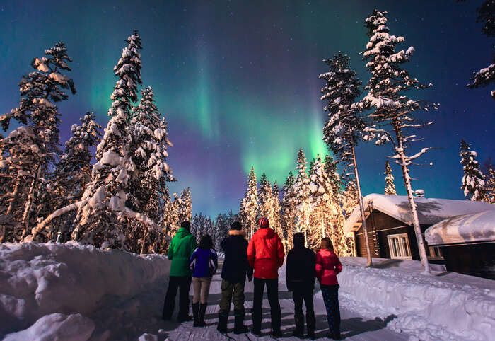 People watching the Northern Lights in Lapland
