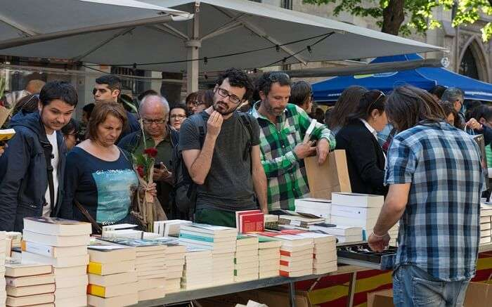 People at literary art festival buying books