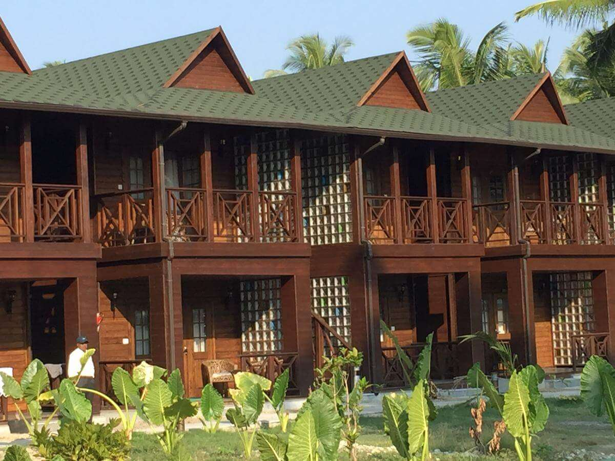 a wooden hotel with a garden