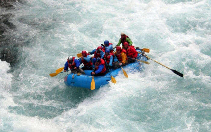 Adventurers taking up river rafting while on their camping trip in Rishikesh