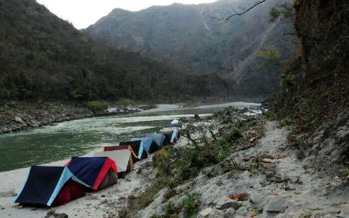 Beautiful tents aligned by the riverside in Rishikesh