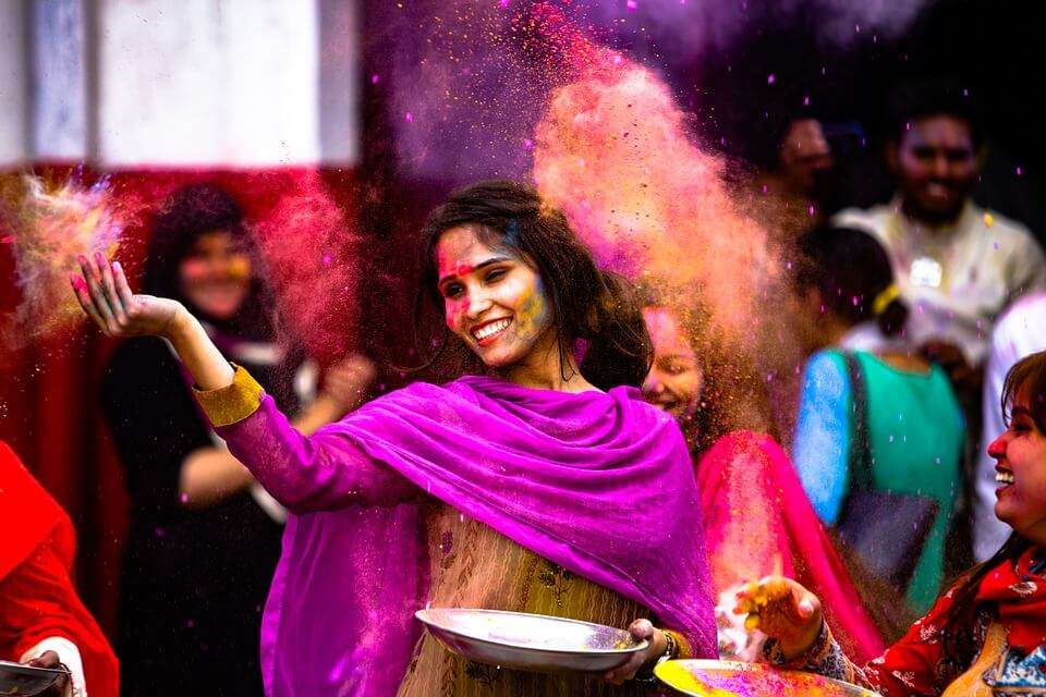 people playing holi with colours
