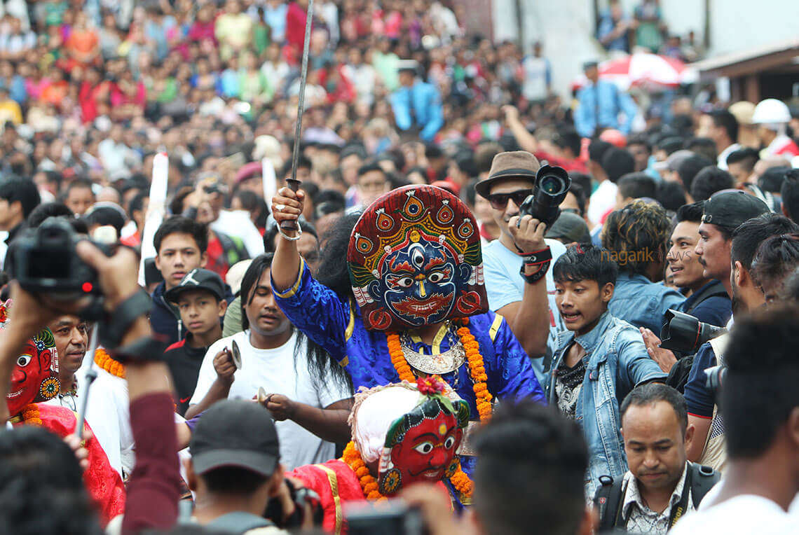 people wearing mask during festival