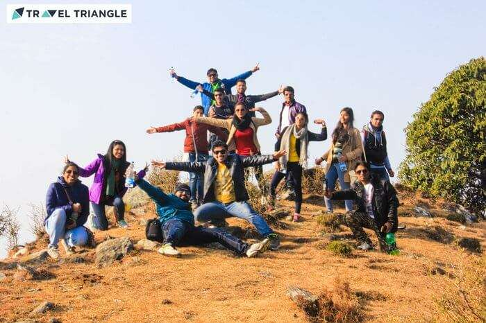 a group of people enjoying happily in hills