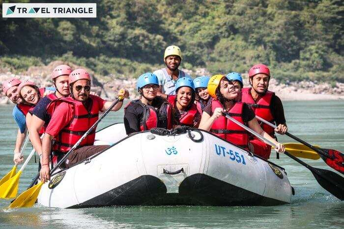 a group of people enjoying rafting