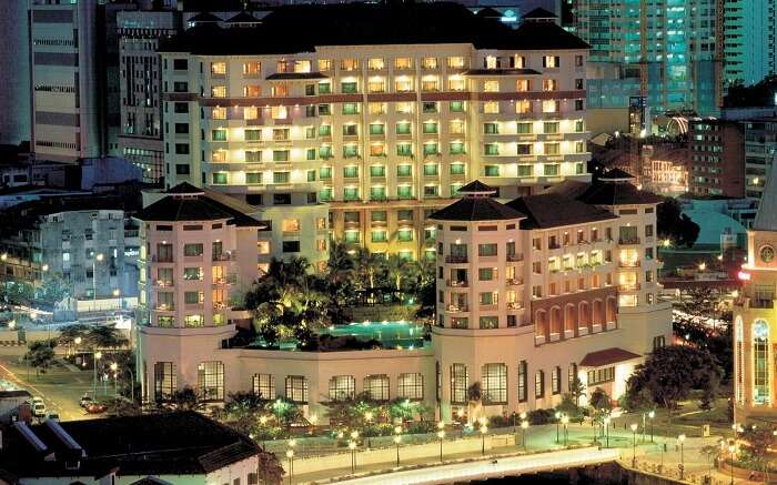 A beautifully lit hotel at night