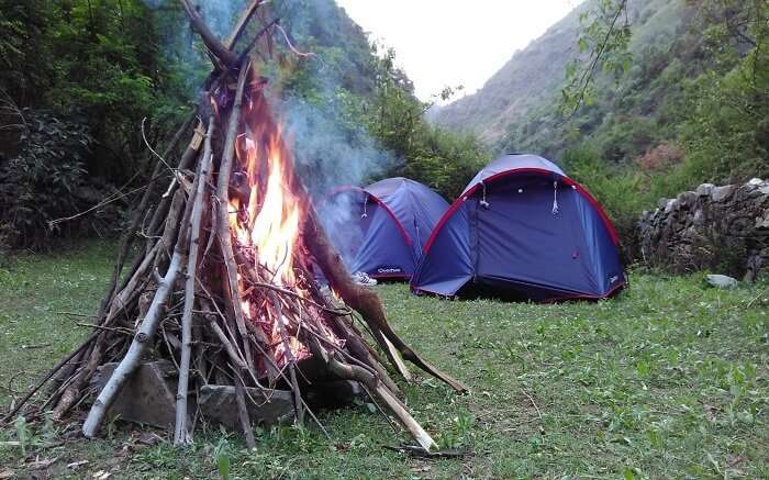 A bonfire made by the tents at a campsite in Shimla