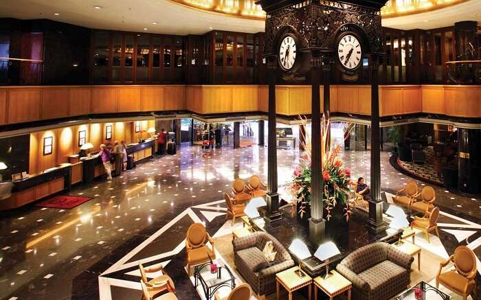 A gorgeous lounge area of a hotel with a huge clock