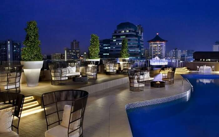 A terrace restaurant in a hotel with swimming pool