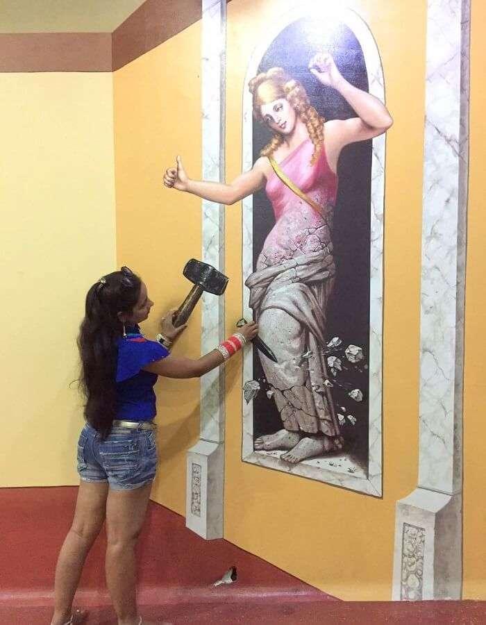 pankaj honeymoon trip to bali: pankaj's wife posing at the 3d art museum in bali
