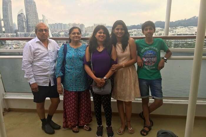 saurabhi singapore family trip: family posing before views from cruise