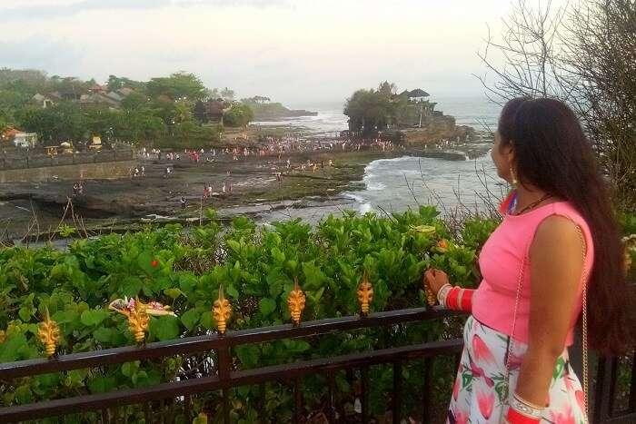 pankaj honeymoon trip to bali: looking at temple in tanah lot