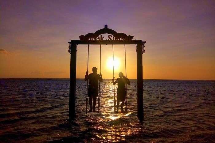 pankaj honeymoon trip to bali: pankaj & wife at sea swing