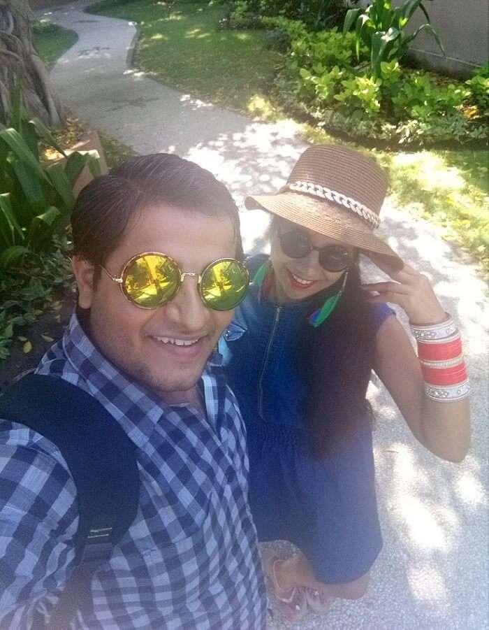 pankaj honeymoon trip to bali: pankaj and wife posing on bali beach