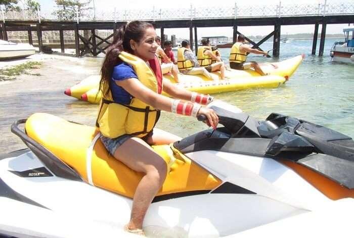 pankaj honeymoon trip to bali: pankaj's wife posing on a jetski