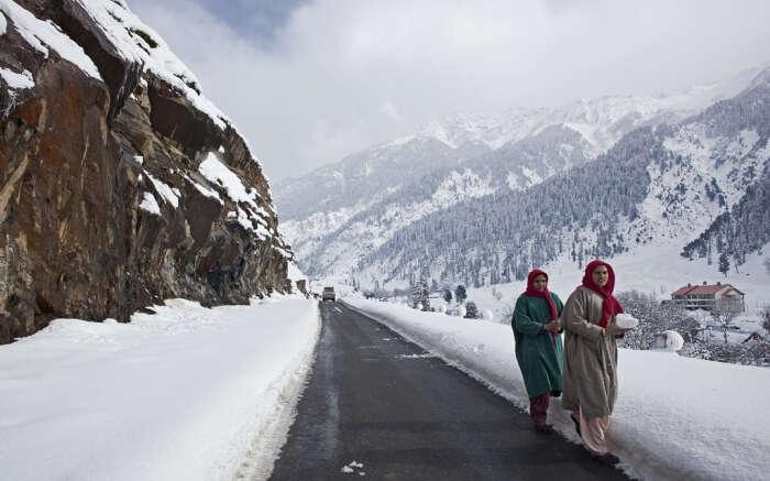 Locals during snow in Kashmir