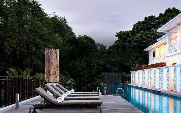 Sun decks near a swimming pool in a luxury hotel