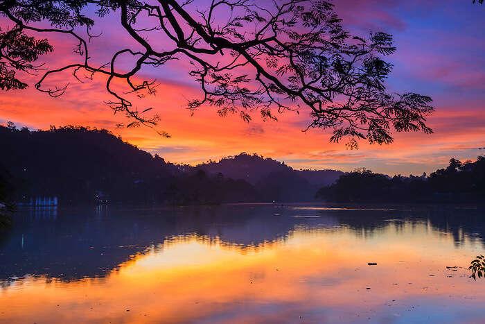 Witness a dramatic sunrise at Kandy Lake in Sri Lanka