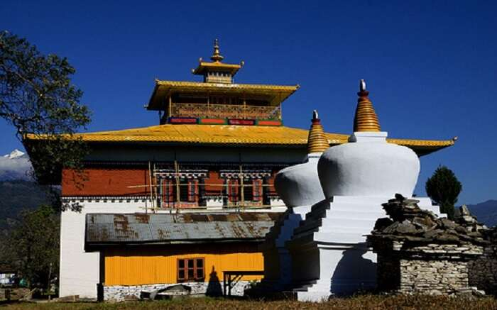 The gompas of Tashiding Monastery overlooking mountains in Sikkim