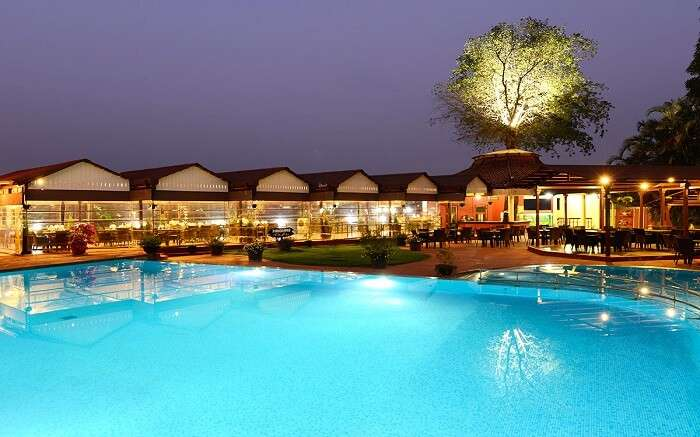 The well-lit property of The Dukes Retreat by the pool in Khandala