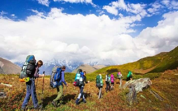 Travelers walking through the mountains in Uttarakhand